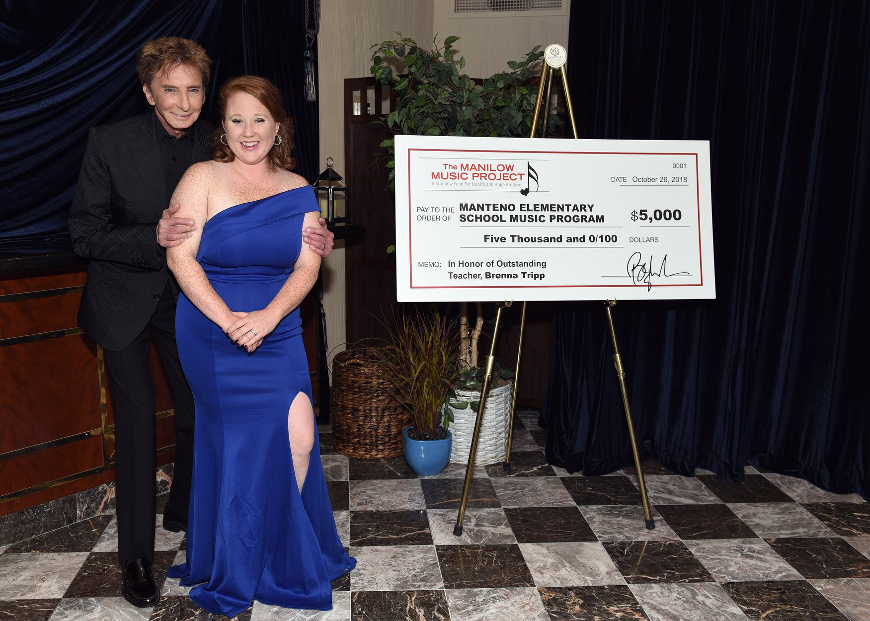 Brenna Tripp of Manteno Elementary School receives $5000 from Barry Manilow and the Manilow Music Project for Manteno's music program